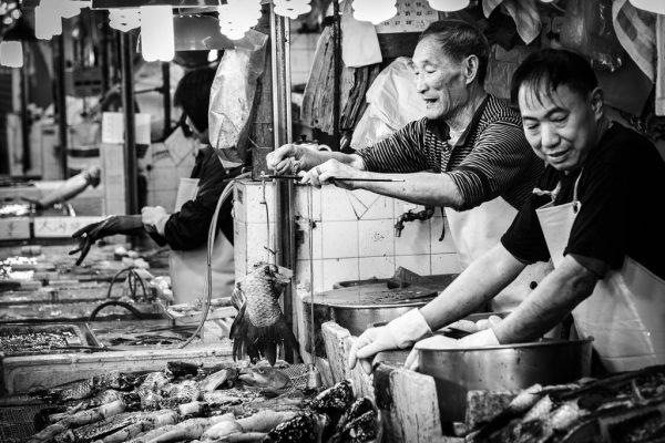 Fishmongers in a Mong Kok wet market.